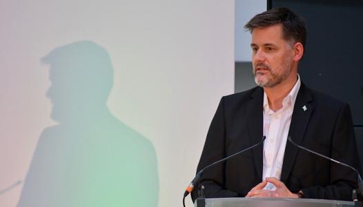 David Owen gives a talk from a podium